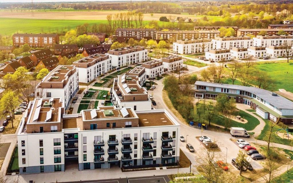 Die Umsetzung des Landeswettbewerbs Weckhoven: Das moderne Quartier an der Hülchrather Straße bietet mit 5,75 Euro/ qm bezahlbare Mietpreise für ihre Bewohner.v