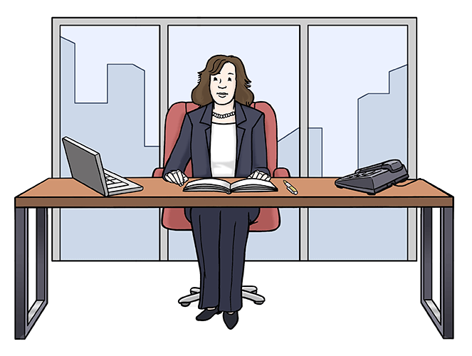 Die Chefin sitzt im Büro am Schreibtisch.