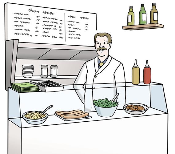 Ein Mann verkauft Essen in einem Imbiss.